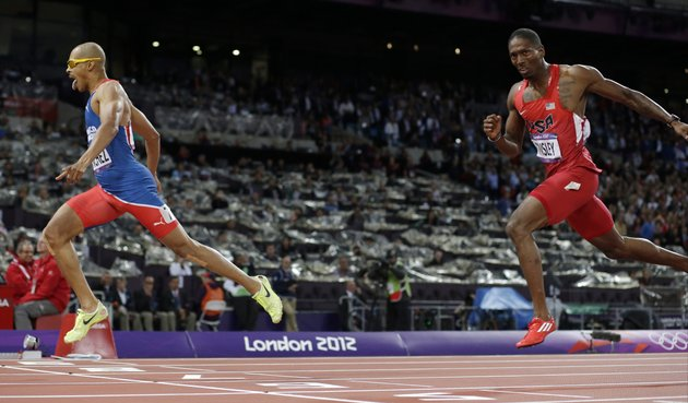 dominican-republics-felix-sanchez-left-crosses-the-finish-line-to-win-ahead-of-united-states-michael-tinsley-in-the-mens-400-meter-hurdles-final-during-the-athletics-in-the-olympic-stadium-at-the-2012-summer-olympics-london-monday