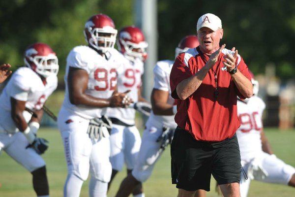 Arkansas strength and conditioning coach Jason Veltkamp helped break up a fight between Mitch Smothers and Darius Pilon on Monday during the Razorbacks' practice.