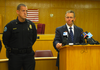 Prosecutor Scott Ellington speaks beside Trumann Police Chief Chad Henson during a news conference Tuesday.