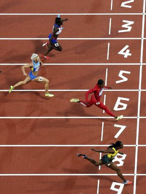 Former Arkansas Razorbacks runner Veronica Campbell-Brown of Jamaica (bottom) edged American Carmelita Jeter by 0.07 seconds to win her semifinal heat in the 200 meters Tuesday in London.