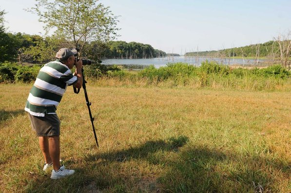Terry Stanfill of the Decatur area photographs birds along the Eagle Watch Nature Trail. Stanfill is a dedicated steward of the trail who organizes activities there for a variety of troups.