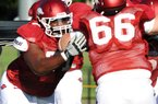 Offensive tackle Jason Peacock is the only one of six Arkansas players arrested in the spring to make it back for fall practice.