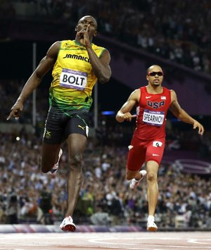 Jamaica sprinter Usain Bolt hopes he's silenced some of his critics by winning another gold medal in the men's 200-meter final Thursday at Olympic Stadium in London. Former Arkansas Razorback Wallace Spearmon of Fayetteville (right) was fourth.