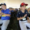 Dylan Poush, 11, left, Mountain Home left fielder, and Johnathon Prescott, 11, center fielder with W...