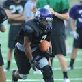 Brayden Cook, Fayetteville running back, carries the ball Tuesday during practice at Harmon Field.