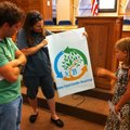 Caroline Solloway, 10, right, of Little Rock, explains Thursday the inspiration behind her artwork t...
