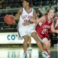 Kara Pongonis-Paslay, right, a former Springdale High guard, shown here in the 2002 Class 5A State T...