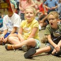 Lincoln Gordon, 5, right, reacts Saturday to a magic trick performed by magician Steven Blythe from ...