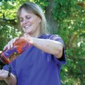 Marge Frazee pours out a glass of water Monday at the Rogers Actiivty Center, where she works. Fraze...