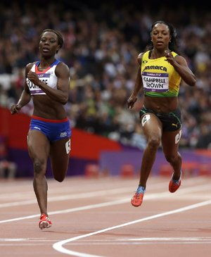 Former Arkansas Razorback sprinter Veronica Campbell-Brown (right) won a silver medal as part of Jamaica's 400 relay team and a bronze medal in the 100 meters during the Olympic games in London. Campbell-Brown was the only athlete with Arkansas ties to take home more than one medal.