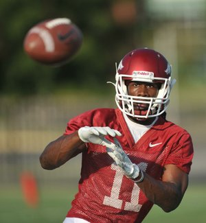 "Arkansas receiver Cobi Hamilton and cornerback Tevin Mitchel have produced perhaps the most competitive pairing during the Razorbacks' camp. ""He's going to win some, I'm going to win some,"" Hamilton said. ""Hopefully I win a lot more than he does."""