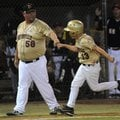 Gan Nunnally, left, Bentonville coach, fist bumps David Marts near third base Tuesday after Marts hi...
