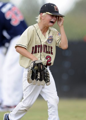Sam Many of Bentonville is overcome Friday after getting pulled from the mound during the fifth inning of the All-Stars' semifinal game against Willamette Valley, Ore., in the Cal Ripken World Series in at Memorial Park in Bentonville. Willamette Valley won 11-5.