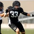 Garrett Kaufman, a Bentonville linebacker, works to get to the ball carrier during practice inside T...