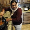 Deepa Almaz prepares biriyani, a goat stew with rice, for her family's fast-breaking meal on Tuesday...