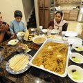 Adbul Haneefa, left, prays Tuesday before he and his wife, Deepa Almaz, break their fast after sunse...