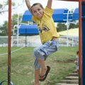 Corey Robert, 6, plays on the monkey bars Friday in Murphy Park in Springdale. Corey was enjoy the c...