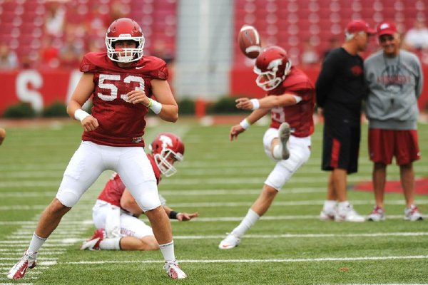 Sophomore deep snapper Alan D'Appollonio (53) is one of five key returning starters for Arkansas' special teams, along with kicker Zach Hocker (right) and holder Brian Buehner (center). Punter Dylan Breeding and kickoff returner Dennis Johnson are also back this season.