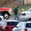 A member of the Bentonville Police Department walks down Southwest Seminole Street from a standoff S...