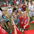 University Of Arkansas freshmen grab free Tshirts as they leave the new student welcome event Sunday...