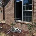 A broken window at a house where a woman was killed Sunday at 804 S.W. Ouachita Drive in Bentonville...