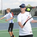 Rogers High School tennis players Austin Wright, left, and Andrew Jones practice Wednesday at the sc...
