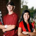 Springdale High tennis players, junior Cory Stewart and senior Alee Kham, take a break from honing s...