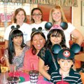 Ximena Walden of Springdale, back row center, a bilingual volunteer for Make-A-Wish Foundation of th...