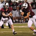 Will Whatley, left, of Springdale hands off to Colton Greenwood on Tuesday at Bulldog Stadium as the...