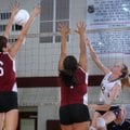 Mariah King, left, and Gabriela Aldaco, center, of Springdale try to block a hit by Shiloh Christian...