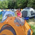 Rumblers sleep in tents at the overnight towns. Lynn Peters of Wisconsin sets her tent up during the...
