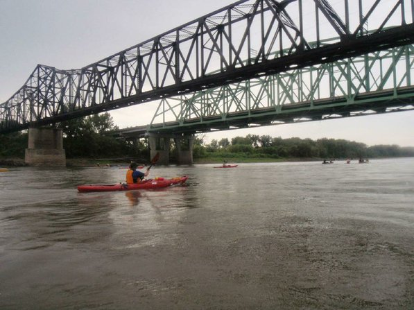 The last day of the Great River Rumble on Aug. 4 brought welcome rain during the morning. Here paddlers travel under bridges near St. Charles, Mo., not far from the Missouri River's confluence with the Mississippi.