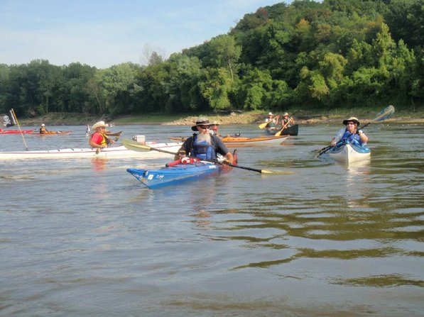 Gary Jean of Virginia, left, and Dave Van Dyne of Kansas City, center, head down the Missouri River on the Great River Rumble.