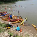 Paddlers stop for a swim break. The Missouri River was low during the trip and sandbar beaches were ...