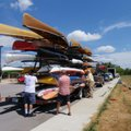 A huge trailer provided by the Wenonah canoe and Current Designs kayak company transported the rumbl...