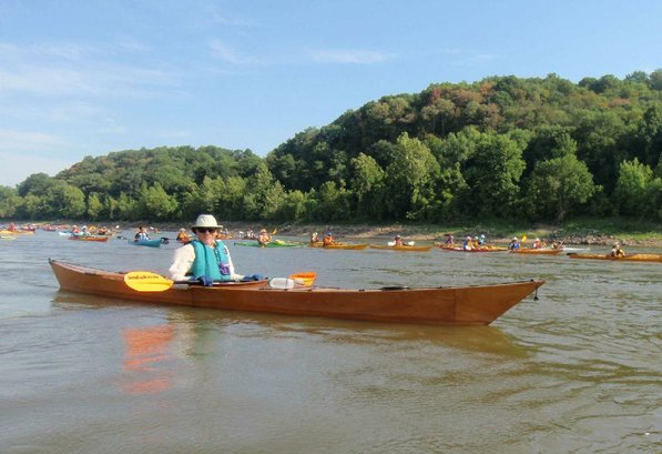 Marv Leister of Fayetteville floats down the Missouri River on the Great River Rumble. Leister paddled a kayak he built himself.