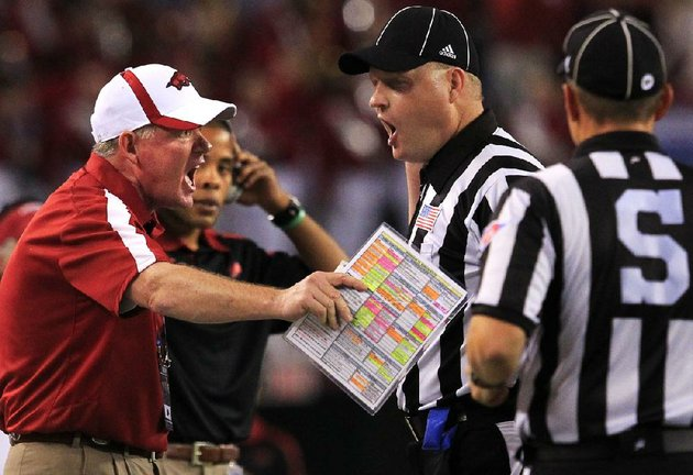 arkansas-democrat-gazettebenjamin-krain-1612-bobby-petrino-argues-a-call-with-the-officials-after-a-penalty-on-a-field-goal-which-forced-the-razorbacks-to-punt-instead