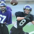 Jake Hornibrook, a Fayetteville defensive back, reaches to intercept a ball during practice at Harmo...