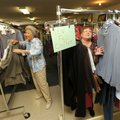 Evelyn McDonald, longtime manager of The Attic, left, helps volunteer Cathy Dalrymple fill a rack of...