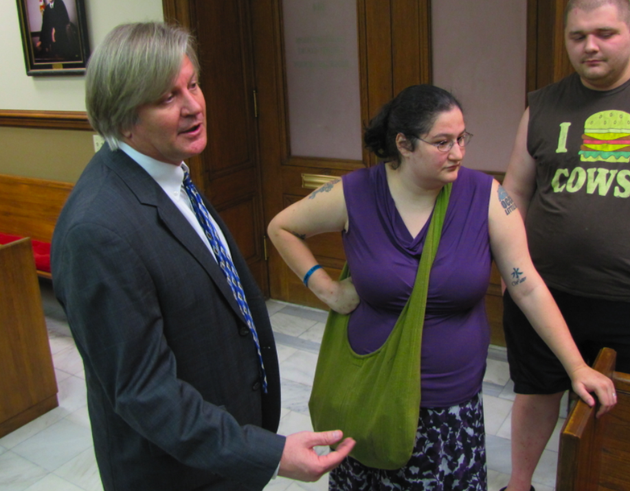 attorney-david-couch-speaks-beside-occupy-little-rock-member-kaitlin-lott-after-a-hearing-friday-in-pulaski-county-circuit-court