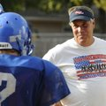 Shane Holland, the Decatur football coach, talks with his players during a recent practice.