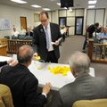 Tyler Clark, chairman of Washington County Democrats, pulls a number Friday for a Democratic candida...