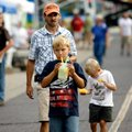Keatan Goss, 9, his father, Keith Goss, and his cousin, Landon Green, right, 7, all of Pea Ridge, wa...