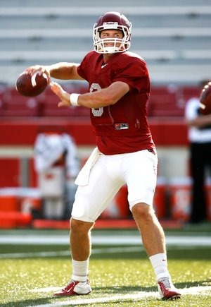 "Arkansas quarterback Tyler Wilson said he and his teammates are aware of the NFL scouts who attend Razorbacks practices. ""You go out and try to play like you always play, or maybe even a little better,"" Wilson said."