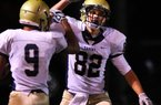 Pulaski Academy tight end Hunter Henry (82) is ranked the No. 52 recruiting prospect in the country by one rating service and is the same size as his father, Mark, an all-Southwest Conference offensive lineman at Arkansas in 1991. Earlier this year, Henry ended the recruiting process when he committed to the Razorbacks.