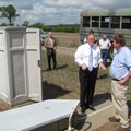 U.S. Sen. Mark Pryor and soils scientist Philip Moore (right) discuss a watershed project on Monday ...