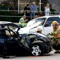 Springdale Fire Department members tend to a Dodge Neon on South Thompson Street on Monday, Aug. 27,...