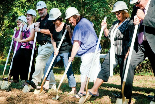 bethlehem-house-executive-director-judi-lively-center-and-board-members-participate-in-tuesdays-groundbreaking-for-the-conway-homeless-shelters-facility-shown-from-the-left-are-kay-satterwhite-amy-kennedy-bob-fason-arlene-montgomery-lively-beth-eakin-and-guy-murphy-jr-the-7200-square-foot-13-million-shelter-is-being-built-down-the-street-from-the-current-one-it-will-be-handicapped-accessible-and-have-room-for-35-residents-as-well-as-eight-emergency-beds-and-administrative-offices
