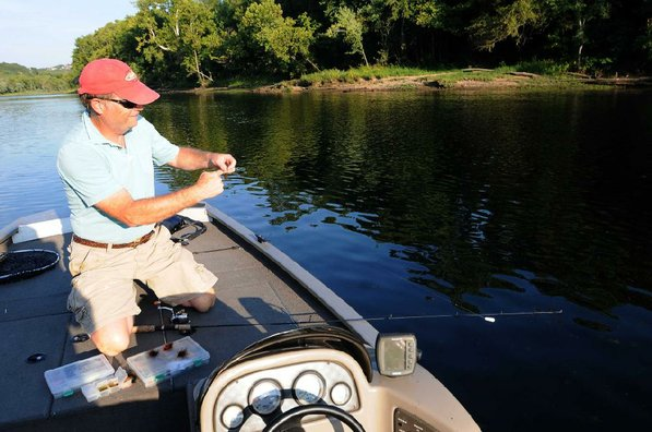 Lilley switches from casting and retrieving a jig to using a jig beneath a float. Both tactics worked to catch rainbow trout during the evening at Lake Taneycomo.