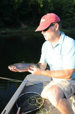 Lilley hooked this trout while fly fishing with a midge.